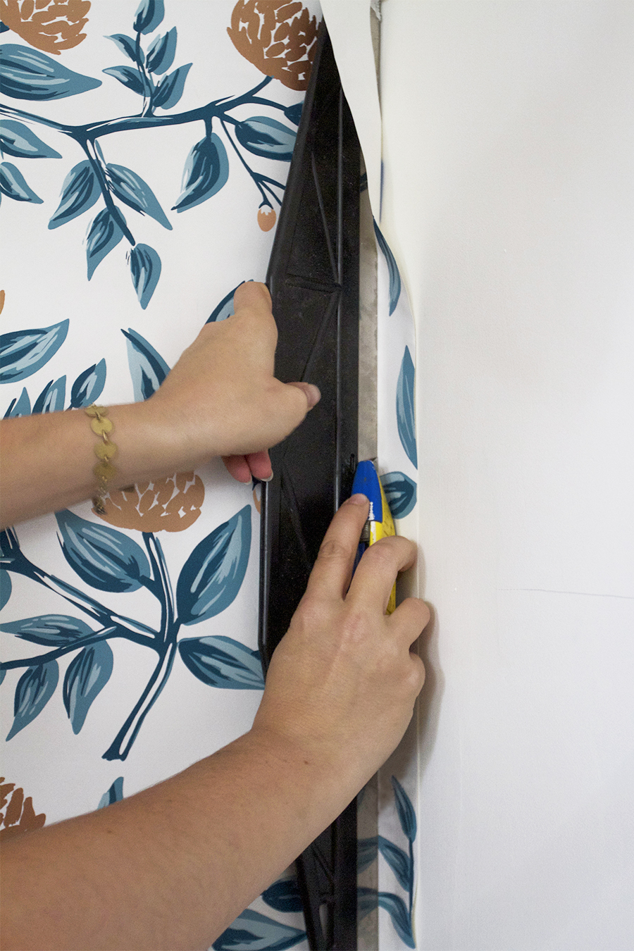Trim Excess Wallpaper with a Straight Edge