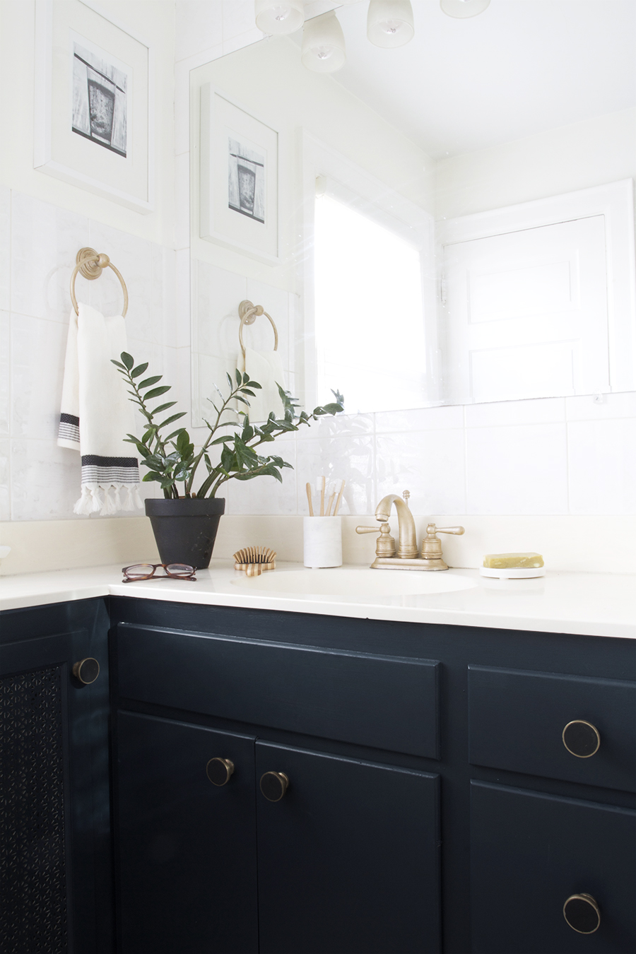Modern Navy Blue Bathroom with Black, White & Brass Accents