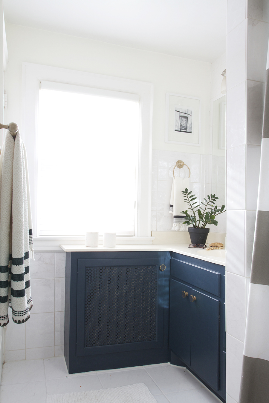 Modern Navy Blue Bathroom with Black, White & Brass Accent