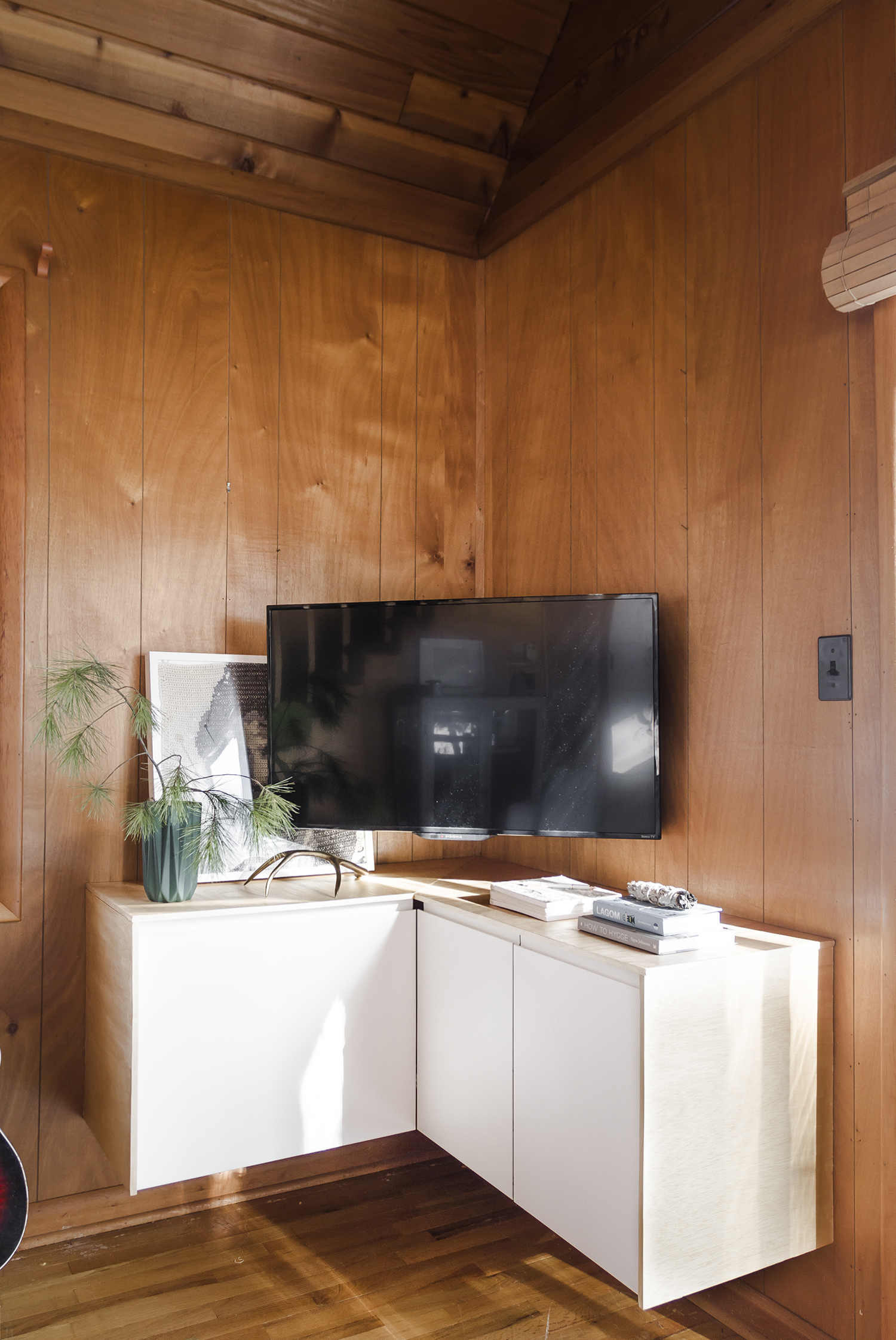 Deucecities Henhouse | Custom Corner TV Credenza using Ikea Kitchen Cabinets