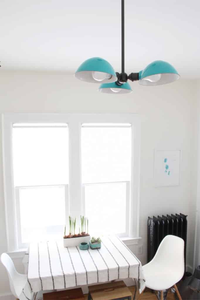 A new Schoolhouse Electric light fixture in the kitchen